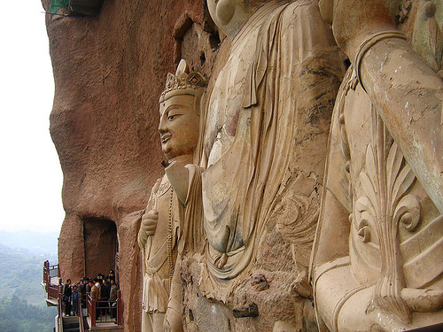 Carved directly from the rock sculptures of Buddhas – The Maijishan Grottoes. Gansu Province, China