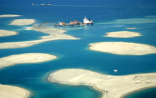 The sand scooped from the bottom of the Persian Gulf and sprayed on the building site to create the island