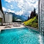 One of the pools opens onto the terrace in the open air and you can admire the wonderful mountain scenery. Tschuggen Grand hotel in Arosa, Switzerland
