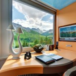 Huge windows provide a panoramic view of the mountains. Tschuggen Grand hotel in Arosa, Switzerland