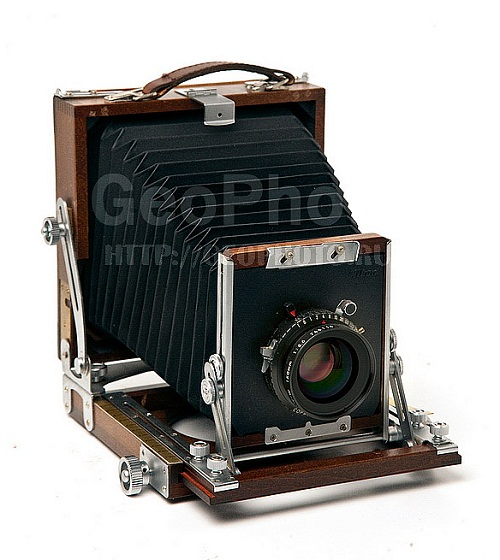 Still life – coins, cameras and retro photographs. Work by Russian photographer Alexander Knyazev