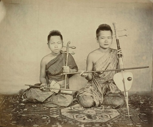 Musicians. Vintage photograph of Siamese men