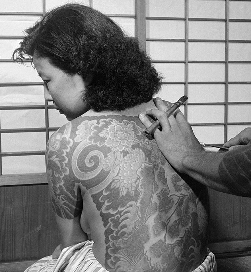 Japanese lady undergoing Head-to-toe tattoos