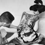 gets a traditional Japanese tattoo, ca. 1930s