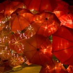 Glowing Umbrella red installation by Australian artist Anna Meister