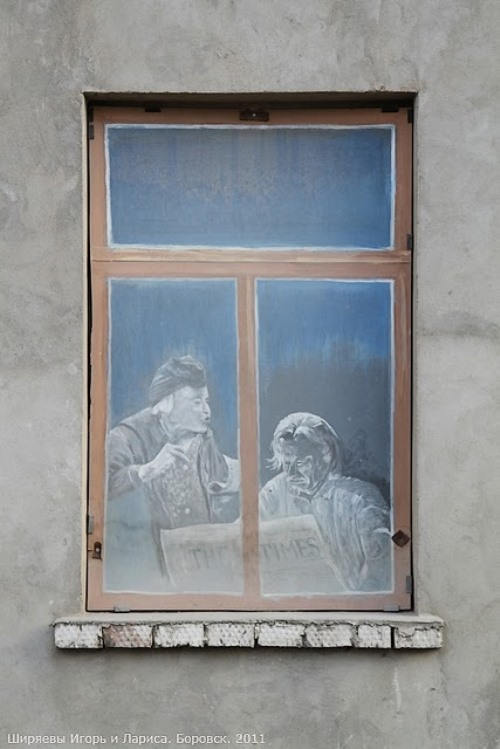 An aged couple behind the window