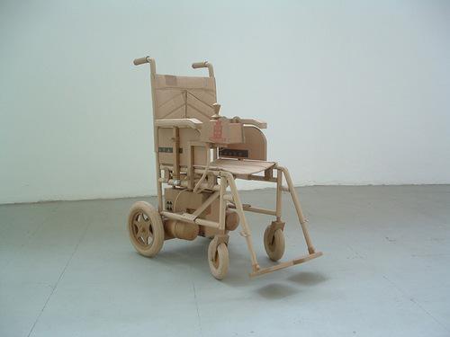 A wheel chair. Cardboard sculpture by British artist Chris Gilmour