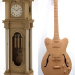Father's clock and a guitar. Cardboard sculpture by British artist Chris Gilmour