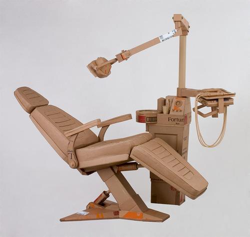 Dentist chair. Cardboard sculpture by British artist Chris Gilmour