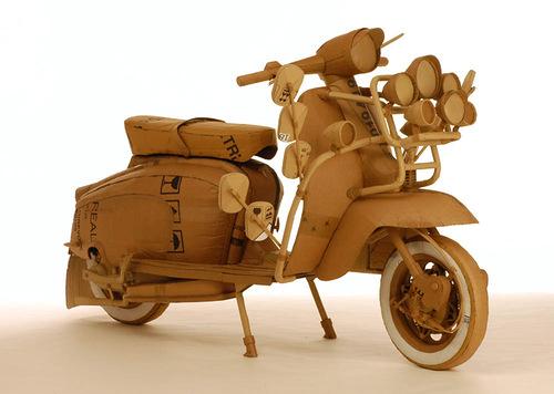 Motor bike. Cardboard sculpture by British artist Chris Gilmour