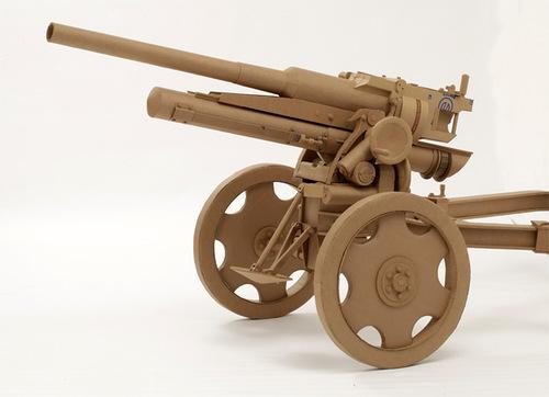 A gun. Cardboard sculpture by British artist Chris Gilmour
