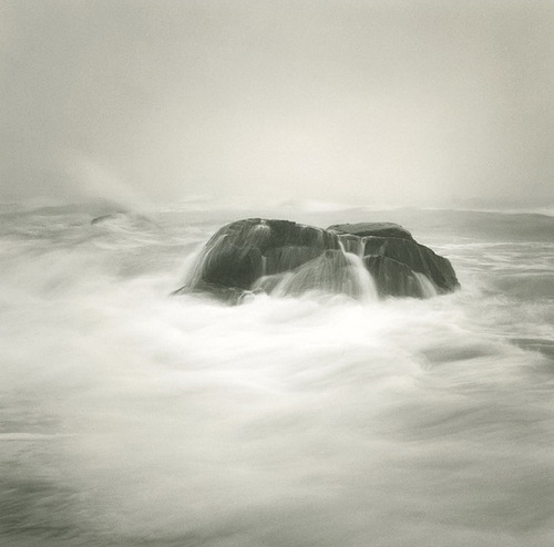 Rocks in the sea. Black & white photo by Canadian photographer Michael Kahn