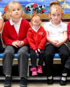 Sitting between classmates