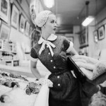 1954, New York, New York, USA. Movie star Tippi Hedren models a black dress in a fish market