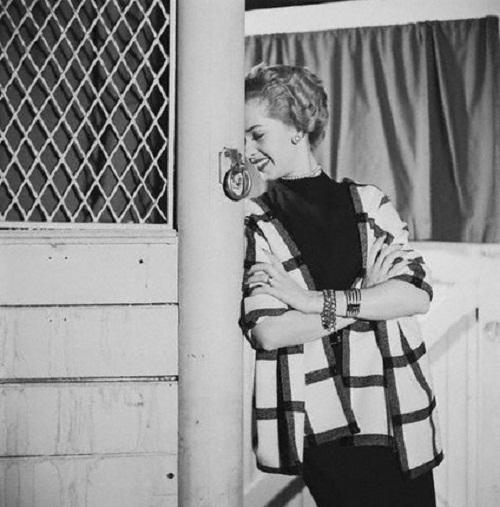 1954, New York, New York, USA. Movie star Tippi Hedren wears an evening dress by Jacques Fath