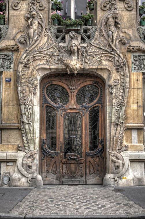 29 Avenue Rapp in the 7th arrondissement, very close to the Eiffel Tower. Built in 1901, this Art Nouveau masterpiece by Jules Lavirotte is quite striking. The detailed door was designed by sculptor Jean-Baptiste Larrive