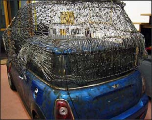 To create a realistic copy of Mini Cooper S at 1:1 author spent more than two hundred hours and 7000 metal nails