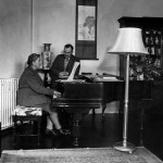 Playing the piano for her husband Max E. L. Mallowan, in March 1946 in their home, Greenway House, in Devonshire