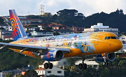 Yellow and blue Aircraft graffiti