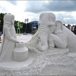 A girl and an elephant. Beautiful Sand sculptures made all over the world