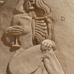 Anatomy. That's quite creepy. Sand sculpture created during annual festival of sand sculpture in Pera, Algarve, Portugal