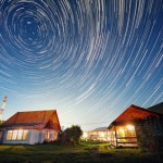 Sky over the village. Starry night of Altai by Russian photographer Vadim Makhorov