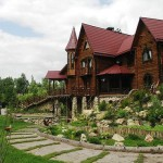 Picturesque houses decorated with garden sculpture