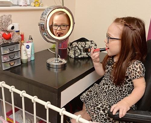 Girls are girls, doing make-up Britain's smallest teenager Georgia Rankin