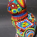 A figure of a cat, Mexico Huichol art