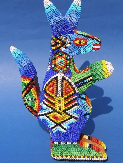Seems like a kangaroo. Huichol art