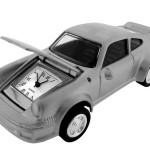 Cool Silver 911 PORSCHE SPORTS CAR, excellent miniature sports car clock. This rendition of a silver 911 Porsche is cast in metal and has a matte silver finish, real treaded rubber tires that will turn