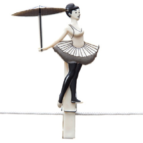 A girl circus gymnast with umbrella walking on a rope. Clothespin from the set Pegzini Family, designed by artists Oded Friedland and Inbal Hoffman