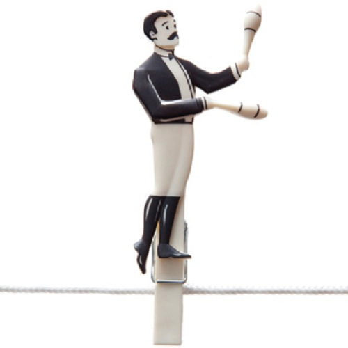 A man performing in the circus. Creative circus clothespins Pegzini Family, designed by artists Oded Friedland and Inbal Hoffman