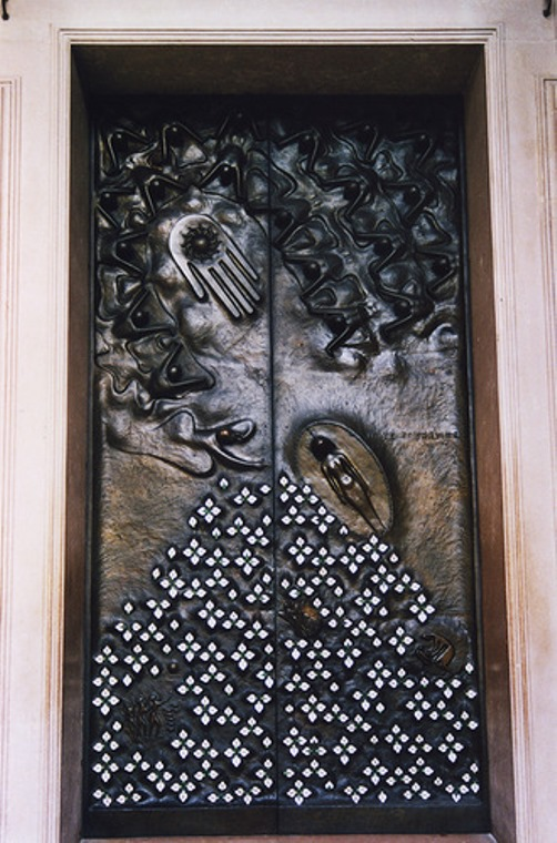 Door 'Hope', one of the three bronze doors of the Salzburger Dom. It was created in 1958 (along with two doors representing Love and Faith) to mark the third reconstruction of the Dom after it had been destroyed in World War II