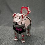 Enamel SPRING DOG Miniature Clock, in the shape of cute dog, cast in sturdy metal with bright silver finish and colored enamel highlights; featuring a quality quartz time piece with silver dial and metallic hands
