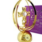 Gold CROSS with Swarovski Crystals stunning miniature clock. Cast in metal with a gold finish, this miniature is in the shape of a Cross on a base with a clean Swarovski crystal embeded at its center