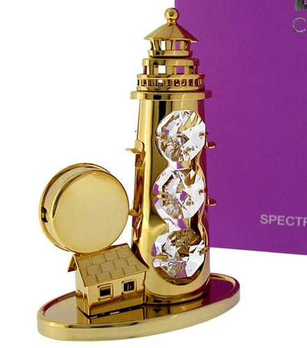 Gold LIGHTHOUSE with Swarovski Crystals, elegant Lighthouse clock with agold finish & Swarovski crystals gleaming from its tower while the ornate timepiece is set upon the living quarters