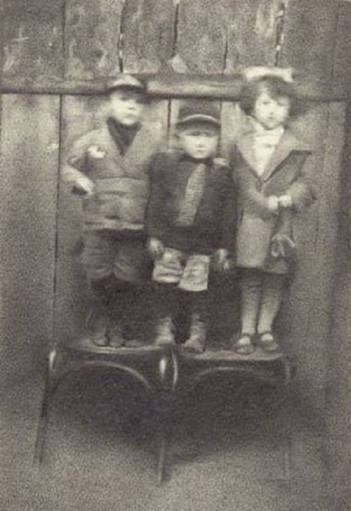 Three children on a chair. Hyperrealistic miniature pencil drawing by Scottish artist Paul Chiappe
