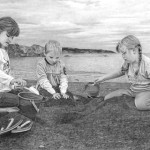Children building sand castle on the beach. Pencil drawing by American self-taught artist Randy Hann