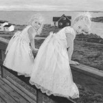 Two beautiful girls in white dresses on the wooden bridge. Pencil drawing by American self-taught artist Randy Hann