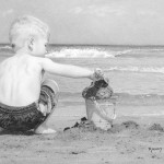 A boy playing on a sandy beach. Hyperrealistic pencil drawing by American self-taught artist Randy Hann