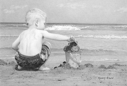 A boy playing on a sandy beach. Hyperrealistic pencil drawing by American self-taught artist Randy Hann