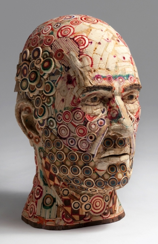 2009. Carl. Recycled wood, pigmented grout, sculpture by American artist Michael Ferris Jr