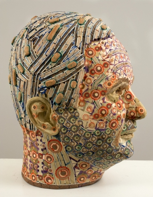 Profile of male head Vincent. 2008. Recycled wood, pigmented grout, sculpture by American artist Michael Ferris Jr
