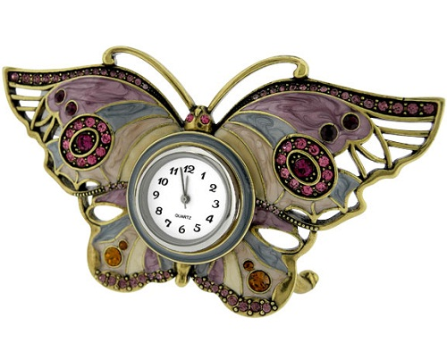 Miniature clock, elaborate BUTTERFLY with gems, magnificent butterfly clock. Cast in sturdy metal with a rich multi-colored enamel finish on its outspread wings and is elaborately decorated with a vast array of sparkling gems