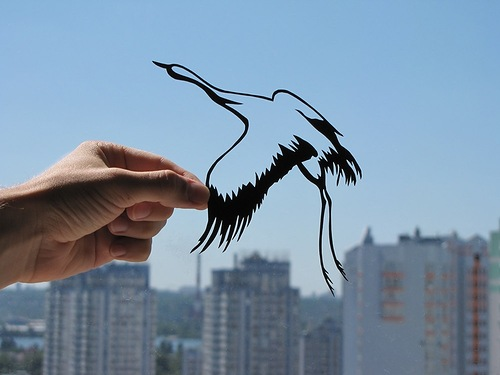 Crane paper silhouette by artists Dmitry and Julia