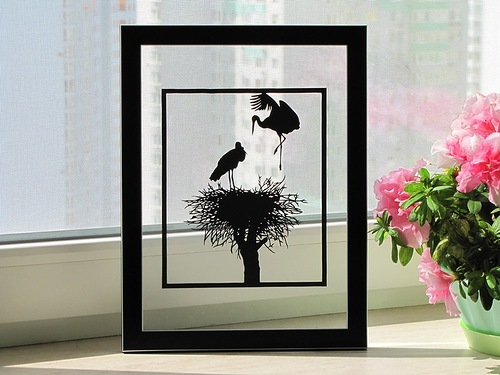 Storks in the nest. Paper silhouette by Dmitry and Julia