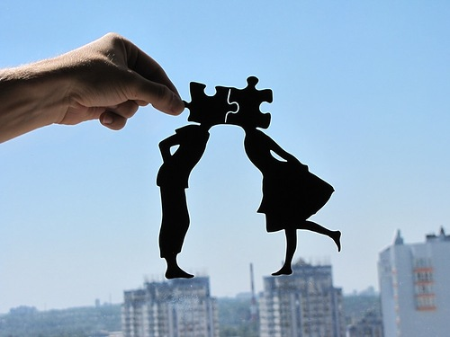 Jig-saw-puzzle kissing girl and boy. Paper silhouettes by Dmitry and Julia