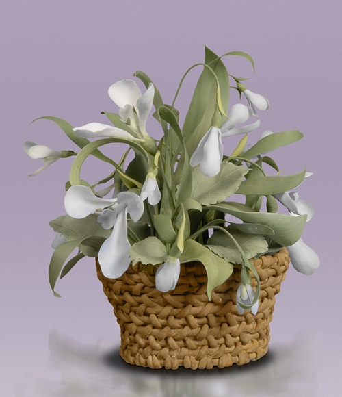 A basket of Porcelain flowers by creative group 'Lyudmila'