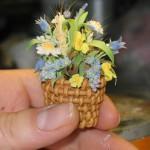 Miniature basket of flowers. Porcelain composition by creative group 'Lyudmila'